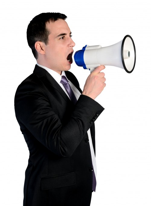 Business man with loudspeaker